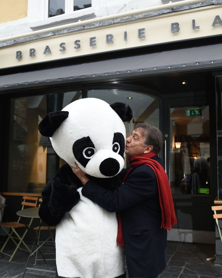LONDON, ENGLAND - FEBRUARY 03:  To kick-start the worldÕs biggest celebration of our planet, Raymond Blanc OBE dines by candlelight with a symbolic panda to show his support for WWFÕs Earth Hour. The top chef and President of Food Made Good invites the nation to follow in his footsteps and dine by candlelight to celebrate Earth Hour at 8.30pm on 19th March. February 3, 2016 in London, England.  (Photo by Stuart C. Wilson/Getty Images for WWF-UK) *** Local Caption *** Ramond Blanc